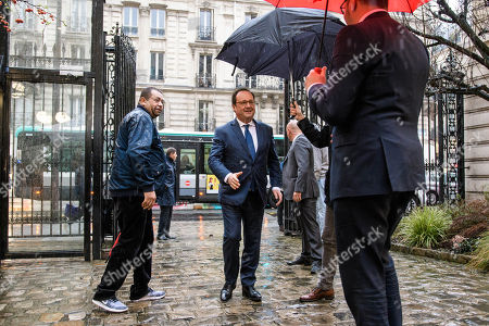 Former French President Francois Hollande (C) is welcomed by Party's spokesman, Rachid Temal (R) as he arrives at the socialist party (PS) headquarter to take part at a vote for the election of a new PS First Secretary in Paris, France, 15 March 2018. Hollande's party faces major difficulties after being defeated at the presidential and legislatives elections in 2017.