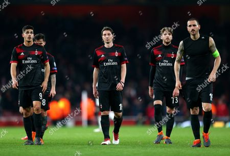 Andre Silva   Riccardo Montolivo   and  Leonardo Bonucci of Ac Milan walk to Ac Milan fans dejected