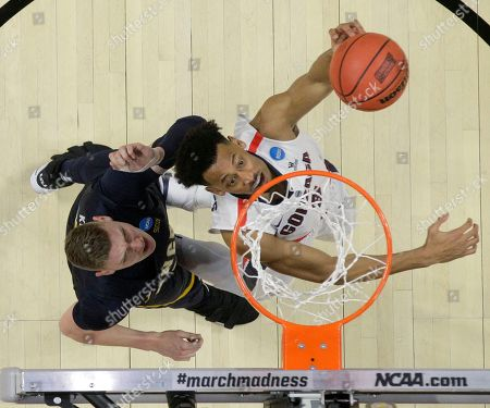 Gonzaga forward Johnathan Williams, right, shoots in front of UNC-Greensboro forward Jordy Kuiper during an NCAA men's college basketball tournament first-round game, in Boise, Idaho. Gonzaga won 68-64