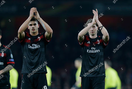AC Milan's Andre Silva, left, and his teammate Riccardo Montolivo at the end of the Europa League round of 16 second leg soccer match between Arsenal and AC Milan at the Emirates stadium in London, Thursday, March, 15, 2018