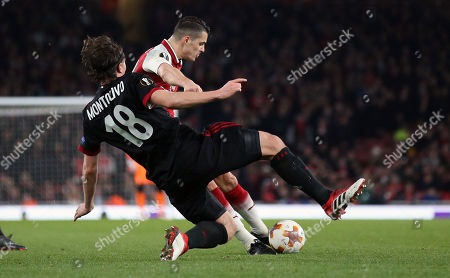 Granit Xhaka of Arsenal scores the 2nd goal with a shot from outside the box as  Riccardo Montolivo of AC Milan challenges