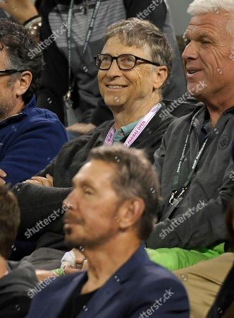 Bill Gates, Larry Ellison. Bill Gates, top, and Larry Ellison, bottom, watch a quarterfinals match between Roger Federer, of Switzerland, and Chung Hyeon, of South Korea, at the BNP Paribas Open tennis tournament, in Indian Wells, Calif