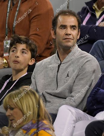 Former tennis player Pete Sampras watches a quarterfinal between Roger Federer, of Switzerland, and Chung Hyeon, of South Korea, at the BNP Paribas Open tennis tournament, in Indian Wells, Calif