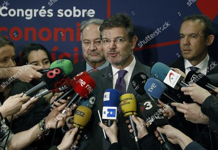 Spanish Justice Minister, Rafael Catala (c), General Council of Procurators of Spain, Juan Carlos Estevez Fernandez Novoa (L) and General Council of Procurators of Catalonia, Ignacio Lopez Chocarro (R) speak to the media during the first Congress on Economy and Justice in Barcelona, Catalonia, Spain, 15 March 2018.