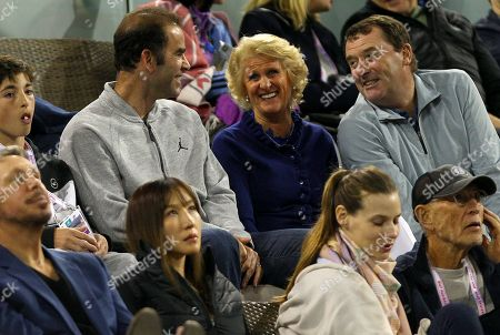 Wimbledon Chairman Philip Brooks and his wife laugh with Pete Sampras