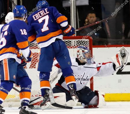 Andrew Ladd, Jordan Eberle. New York Islanders left wing Andrew Ladd (16) and center Jordan Eberle (7) watch as Washington Capitals goaltender Philipp Grubauer (31), of Germany, makes a save during the third period of an NHL hockey game in New York, . The Capitals defeated the Islanders 7-3