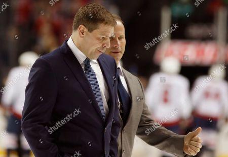 Doug Weight, Greg Cronin. New York Islanders coach Doug Weight, left, walks across the ice with associate coach Greg Cronin after the Islanders lost 7-3 in an NHL hockey game to the Washington Capitals in New York