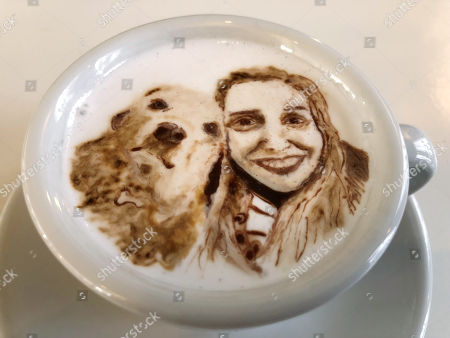 This, photo shows a portrait of Associated Press writer Ashley Thomas with her dog Sandra, designed atop a cup of cold java by Barista Lee Kang Bin at his coffee shop in Seoul, South Korea. The South Korean barista is charming customers at his coffee shop by drawing intricate artworks on the foamy cream toppings of their drinks