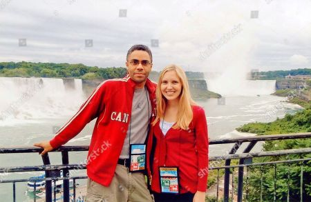 In this 2010 photo, Associated Press writers Dino Hazell and Ashley Thomas pose at Niagara Falls, Canada. Lee Kang Bin, a South Korean barista, recently used the photo to recreate an artwork with the foamy cream toppings of their drinks at his coffee shop in South Korea