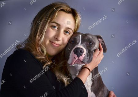 """Lauren Gray poses for a photo in Bridgeport, Ct., with her rescued Pit Bull named Georgia. A California law regulating anti-abortion pregnancy centers has led to a Supreme Court clash at the intersection of abortion and free speech. The centers say a law requiring them to tell pregnant clients the state has family planning and abortion care available at little or no cost violates the centers' free speech rights. Gray became pregnant when she was in college in western North Carolina. Estranged from her mother, somewhat ashamed and very confused, """"I did not know where to turn,"""" she said. When she showed up for her appointment, Gray said the center seemed like a typical medical office. Gray said, """"She clearly stated that we are a pro-life center. We will talk about options for keeping the baby or giving it up for adoption. I said I was very confused and that I wanted to talk about all the options,"""" Gray said. She grew upset and soon left end did have an abortion. Gray said she felt misled because """"I thought I was going to a medical facility that would give me honest and accurate information that I, as a woman, felt I needed and deserved"""