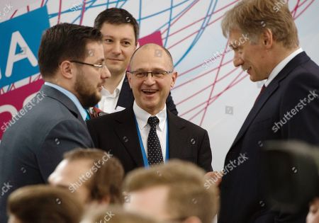 First Deputy Head of the Presidential Administration of Russia Sergei Kiriyenko (center) and presidential press secretary Dmitry Peskov (right)