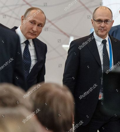 Russian President Vladimir Putin (left) and first Deputy Head of the Presidential Administration of Russia Sergei Kiriyenko (right) during the forum