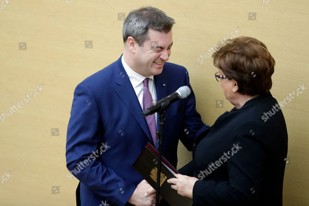 Stock Image of Parliament president Barbara Stamm congratulates new Bavarian State Governor Markus Soeder in the Bavarian parliament in Munich, Germany