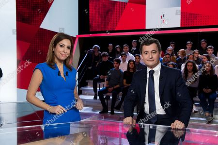 French Budget Minister Gerald Darmanin poses with journalist Lea Salame