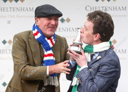 Snooker player Ken Doherty shares a joke with former England cricketer Phil Tufnell
