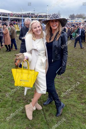 Lisa Maxwell and Carol Vorderman on the racecourse as they wait for the Timico Cheltenham Gold Cup Chase