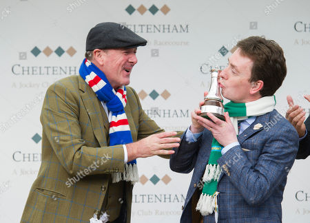 Ken Doherty representing Ireland kisses The BetBright Prestbury Cup as Ireland beat Great Britain, represented by Phil Tufnell, to the most wins in The Festival