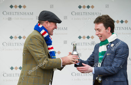 Phil Tufnell representing Great Britain gives Ken Doherty representing Ireland the The BetBright Prestbury Cup which celebrates the annual challenge between Great Britain and Ireland for the most wins in The Festival