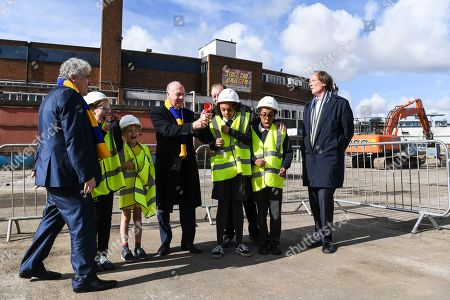Council Leader Stephen Alambritis (far left) AFC Wimbledon legend Ian Cooke (centre left), AFC Wimbledon legend Dave Bassett (centre right), Chief Executive Erik Samuelson (far right) and children from both Smallwood Primary School and children from AFC Wimbledon player development programme during the AFC Wimbledon Demolition Event, marking the start of building works at the AFC Wimbledon Stadium Site, Plough Lane. Picture by Stephen Wright