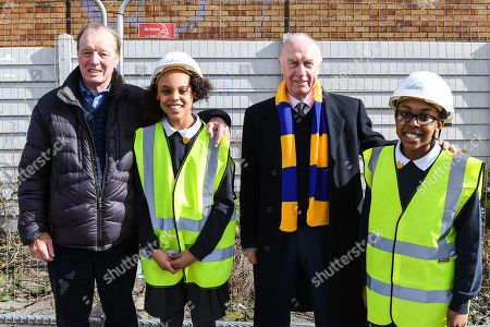 AFC Wimbledon legend Dave Bassett and AFC Wimbledon legend Ian Cooke with children from Smallwood Primary School during the AFC Wimbledon Demolition Event, marking the start of building works at the AFC Wimbledon Stadium Site, Plough Lane. Picture by Stephen Wright