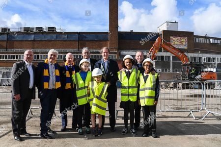 (left to right) Mike Watson from Galliard Homes, Council Leader Stephen Alambritis, AFC Wimbledon legend Ian Cooke, Victor Clinton-Dove from Catalyst, Chief Executive Erik Samuelson, AFC Wimbledon legend Dave Bassett, and children from both Smallwood Primary School and children from AFC Wimbledon player development programme during the AFC Wimbledon Demolition Event, marking the start of building works at the AFC Wimbledon Stadium Site, Plough Lane. Picture by Stephen Wright
