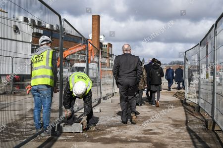 AFC Wimbledon legend Ian Cooke, Chief Executive Erik Samuelson, Council Leader Stephen Alambritis, AFC Wimbledon legend Dave Bassett and other AFC Wimbledon staff make their way to watch the demolition event, marking the start of building works at the AFC Wimbledon Stadium Site, Plough Lane. Picture by Stephen Wright