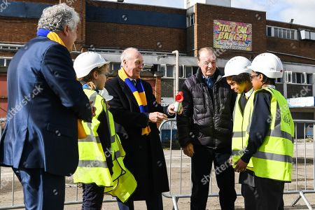 Council Leader Stephen Alambritis (far left) AFC Wimbledon legend Ian Cooke (centre left), AFC Wimbledon legend Dave Bassett (centre right) and children from both Smallwood Primary School and children from AFC Wimbledon player development programme during the AFC Wimbledon Demolition Event, marking the start of building works at the AFC Wimbledon Stadium Site, Plough Lane. Picture by Stephen Wright