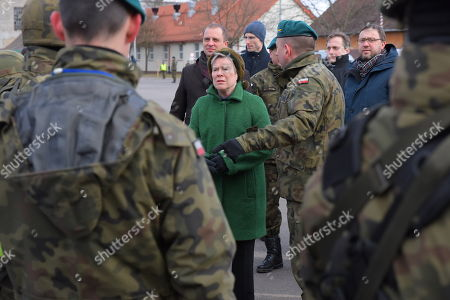 Deputy Secretary General of NATO Rose Gottemoeller (C) and Polish Undersecretary of State in the Ministry of National Defense Tomasz Szatkowski (C-L) during a meeting with NATO combat group soldiers in Bemowo Piskie, northern Poland, 16 March 2018.