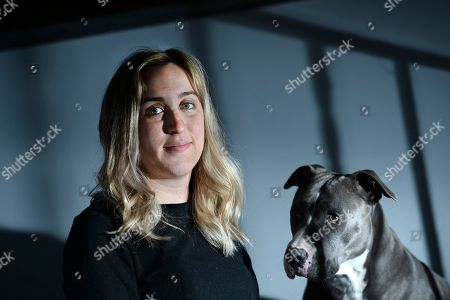 Lauren Gray poses for a photo with her rescued Pit Bull named Georgia in Bridgeport, Ct