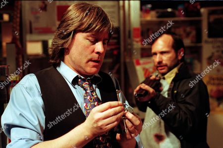 Ep 2463 Friday 25th December 1998 With the Woolpack running short of food, Vic goes to the Post Office to help them out only to find Billy Hopwood robbing the shop. Finding himself held at gunpoint, the two soon become locked in a struggle as Vic tries to sound the alarm. Tragedy strikes when Vic falls and smashes his head against some shelves. Vic pleads for an ambulance but Billy runs off - With Vic Windsor, as played by Alun Lewis ; Billy Hopwood, as played by David Crellin.