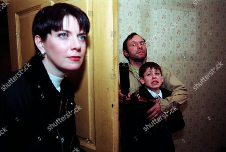 Ep 2458 Thursday 17th December 1998 As Andy takes his dad more food, there's a sound at the door of the derelict Glover home. It's Laura and a workman come to mend the broken lock. Laura walks into the house and stands only inches from discovering them before turning to walk away - With Laura Johnstone, as played by Louise Beattie ; Billy Hopwood, as played by David Crellin; Andy Hopwood, as played by Kelvin Fletcher.