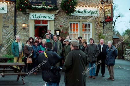Ep 2454 Wednesday 9th December 1998  The villagers gather for the grand re-opening of The Woolpack, but Seth's speech goes slightly awry when he suggests it would have been nicer had Terry been around - and that he still pines for the days of Amos Brearley and Henry Wilks - With Seth Armstrong, as played by Stan Richards ; Alan Turner, As played by Richard Thorp ; Jack Sugden, as played by Clive Hornby ; Tricia Stokes, as played by Sheree Murphy ; Kelly Windsor, as played by Adele Silva ; Vic Windsor, as played by Alun Lewis ; Mandy Dingle, as played by Lisa Riley ; Ned Glover, as played by Johnny Leeze ; Sarah Sugden, as played by Alyson Spiro ; Betty Eagleton, as played by Paula Tilbrook ; Zak Dingle, as played by Steve Halliwell ; Roy Glover, as played by Nicky Evans.