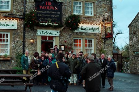 Stock Photo of Ep 2454 Wednesday 9th December 1998  The villagers gather for the grand re-opening of The Woolpack, but Seth's speech goes slightly awry when he suggests it would have been nicer had Terry been around - and that he still pines for the days of Amos Brearley and Henry Wilks - With Seth Armstrong, as played by Stan Richards ; Alan Turner, As played by Richard Thorp ; Jack Sugden, as played by Clive Hornby ; Tricia Stokes, as played by Sheree Murphy ; Kelly Windsor, as played by Adele Silva ; Vic Windsor, as played by Alun Lewis ; Mandy Dingle, as played by Lisa Riley ; Ned Glover, as played by Johnny Leeze ; Sarah Sugden, as played by Alyson Spiro ; Betty Eagleton, as played by Paula Tilbrook ; Zak Dingle, as played by Steve Halliwell ; Roy Glover, as played by Nicky Evans.