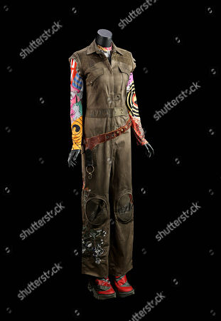 Kaylee Frye's (Jewel Staite) costume from Joss Whedon's sci-fi adventure film Serenity. Kaylee wore her jumpsuit and graphic top during the crew's heist at the beginning of the film