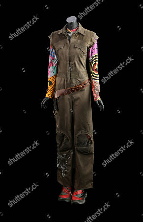 Stock Image of Kaylee Frye's (Jewel Staite) costume from Joss Whedon's sci-fi adventure film Serenity. Kaylee wore her jumpsuit and graphic top during the crew's heist at the beginning of the film
