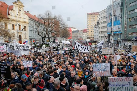 People celebrate the resignation of Prime Minister Robert Fico and his government as a way out of the political crisis triggered by the slayings of an investigative journalist and his fiancee, during an rally in Bratislava, Slovakia