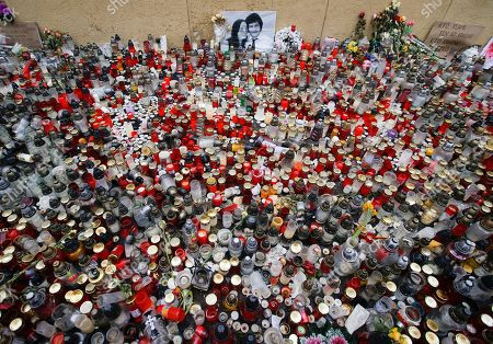 Candles are placed in memory of slain journalist Jan Kuciak and his fiancee Martina Kusnirova as Slovaks celebrate the resignation of Prime Minister Robert Fico and his government as a way out of the political crisis triggered by the slayings of an investigative journalist and his fiancee, during a rally in Bratislava, Slovakia