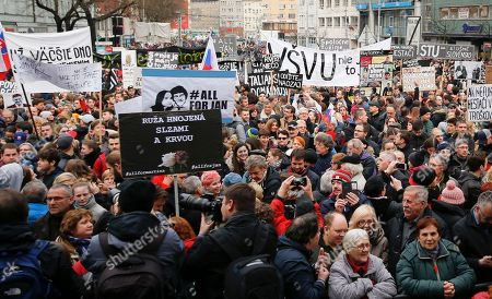 People celebrate the resignation of Prime Minister Robert Fico and his government as a way out of the political crisis triggered by the slayings of investigative journalist Jan Kuciak and his fiancee Martina Kusnirova, during an rally in Bratislava, Slovakia
