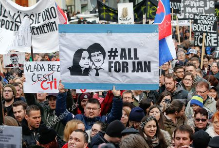 People celebrate the resignation of Prime Minister Robert Fico and his government as a way out of the political crisis triggered by the slayings of investigative journalist Jan Kuciak and his fiancee Martina Kusnirova, during a rally in Bratislava, Slovakia