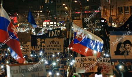 People flash the lights of their mobile phones as they celebrate the resignation of Prime Minister Robert Fico and his government as a way out of the political crisis triggered by the slayings of investigative journalist Jan Kuciak and his fiancee Martina Kusnirova, during a rally in Bratislava, Slovakia