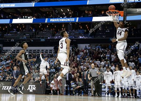 Robert Williams, Admon Gilder. Texas A&M's Robert Williams (44) dunks against Providence as teammate Admon Gilder (3) celebrates during the second half of a first-round game in the NCAA men's college basketball tournament in Charlotte, N.C