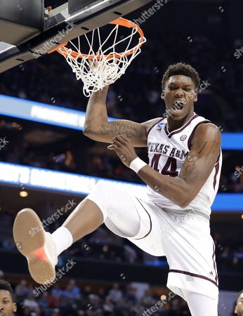 Texas A&M's Robert Williams (44) celebrates after a dunk against Providence during the second half of a first-round game in the NCAA men's college basketball tournament in Charlotte, N.C