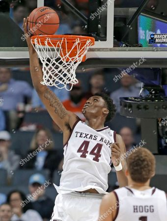 Texas A&M's Robert Williams (44) dunks against Providence during the second half of a first-round game in the NCAA men's college basketball tournament in Charlotte, N.C