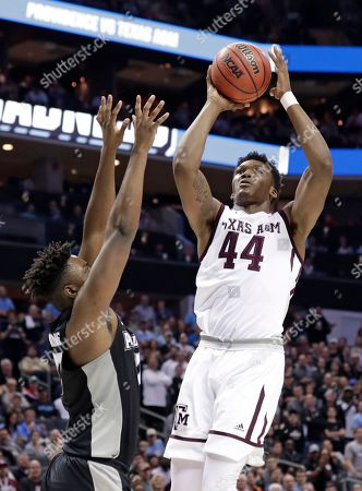 Robert Williams, Rodney Bullock. Texas A&M's Robert Williams (44) shoots over Providence's Rodney Bullock (5) during the second half of a first-round game in the NCAA men's college basketball tournament in Charlotte, N.C