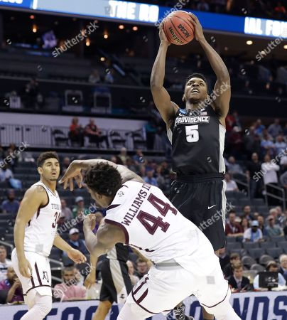 Rodney Bullock, Robert Williams. Providence's Rodney Bullock (5) shoots over Texas A&M's Robert Williams (44) during the first half of a first-round game in the NCAA men's college basketball tournament in Charlotte, N.C
