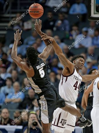 Rodney Bullock, Robert Williams. Providence's Rodney Bullock (5) is fouled by Texas A&M's Robert Williams (44) during the first half of a first-round game in the NCAA men's college basketball tournament in Charlotte, N.C