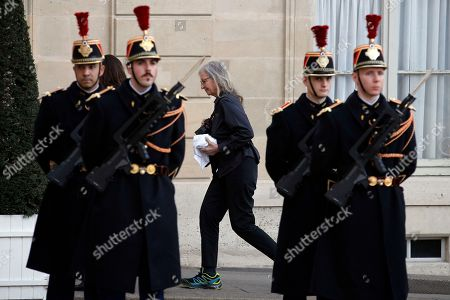 US photographer Annie Leibovitz arrives to photograph French President Emmanuel Macron and Chancellor Angela Merkel during their meeting at the Elysee Palace in Paris, . German Chancellor Angela Merkel is heading to France to meet President Emmanuel Macron in her first trip abroad since her new government was sworn in