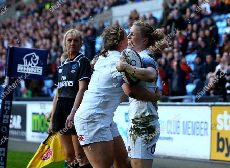 Danielle Waterman of England celebrates with teammates after scoring a try