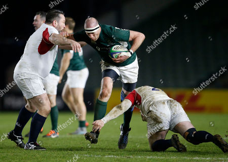 Stock Image of England Legends XV vs Ireland Legends XV. Ireland's Paddy Johns is tackled by Kevin Yates and George Chuter of England