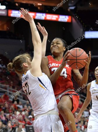 Lauren Van Kleunen, Javonna Layfield. Dayton guard Javonna Layfield (34) attempts a lay-up over the defense of Marquette guard Lauren Van Kleunen (42) during a first-round game in the NCAA women's college basketball tournament in Louisville, Ky